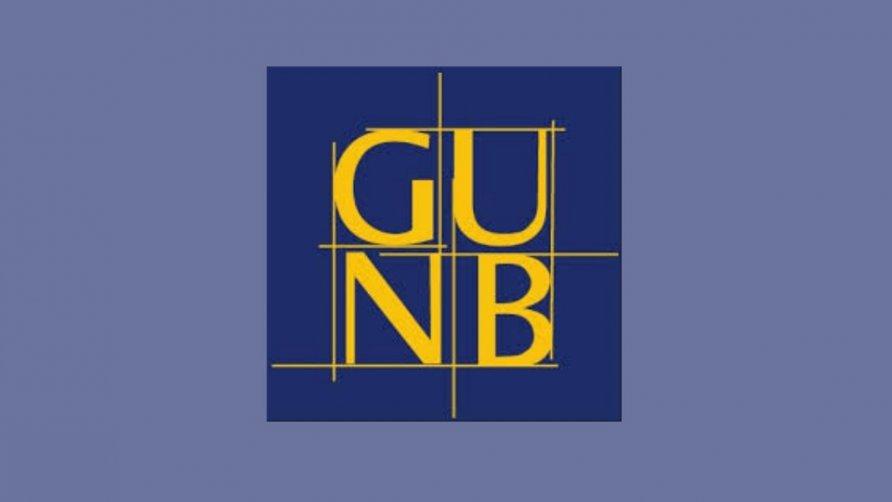 Grafika przedstawia logo Głównego Urzędu Nadzoru Budowlanego tj. złote litery GUNB na niebieskim tle