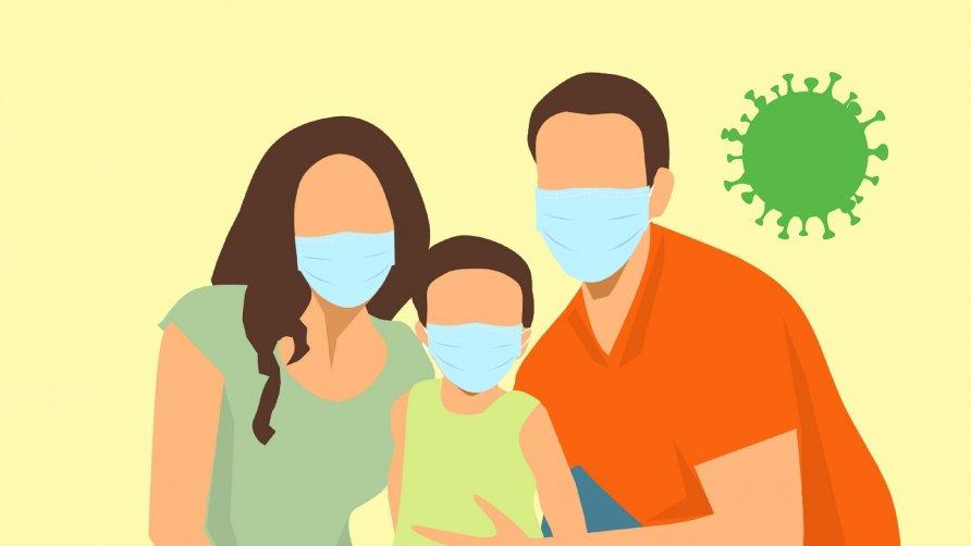 Grafika przedstawia rysunkową rodzinę w maseczkach chroniącą się przed unoszącym się w powietrzu wirusem
